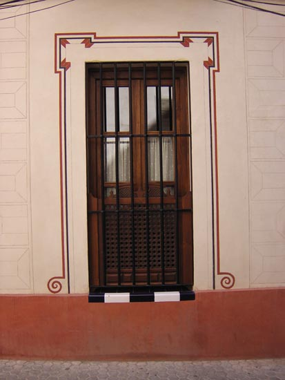 Estucos esgrafiados en fachada
